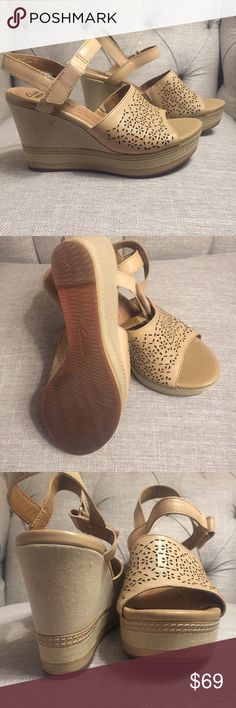 CLARKS NWOB Tan Cutout Wedges Size 7 NWOB Pristine condition. Main upper is leather with cutouts. Platform has canvas covering wedge with leather strip at sole. Never worn. Brand new. Retail $145. Clarks Shoes Wedges