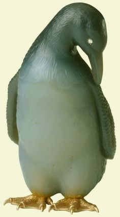 The Royal Collection: Penguin - Queen Alexandra purchased 'penguins agate orletz' from the London branch of Fabergé on 13 November 1911. The penguin was a model which Cartier also produced as part of their range of hardstone animals, inspired by Fabergé.  Mark of Henrik Wigström; gold mark 72 zolotniks (1896-1908)