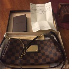 Louis Vuitton Eva clutch damier Almost new, worn only a few times. Great condition, no signs of wear. Comes w/ everything including receipt. NO trades! I Can do peypel and u pay shipping here so u can track ur package Louis Vuitton Bags Crossbody Bags