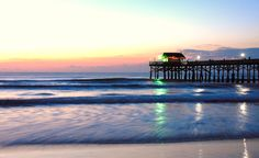 Cocoa Beach Pier... I enjoyed a margarita in the hut at the end of the pier!