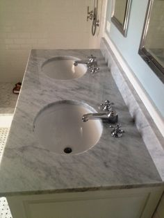A Custom Marble Vanity And Backsplash