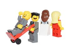 Lego Wedding Minifigures:  Wedding groom and best man fooling about, Lego minifigures.  Image 1000 x 700 compressed.  Copyright © 2016 · BrickTwist.com
