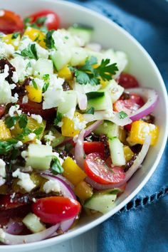 Easy Mediterranean Salad - Enjoy this delicious and Easy Mediterranean Salad made with cherry tomatoes, cucumber, bell pepper and red onions. It is a great option for summer lunch.