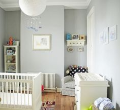 I'd recommend a light, nuetral grey for the walls. It'll allow all the colors to pop really nicely, and all the punches of white will be crisp next to it. Plus, it's a great neutral that will transition nicely as the girls grow.
