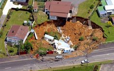 In December 2001, a house in Waihi, New Zealand, collapsed into a huge hole measuring 50 metres wide and 15 metres deep. A family of five, including three young children, escaped serious injury despite their home crashing into a chasm created by an old mine shaft collapsing in the middle of the night. Picture: Dean Purcell/AP