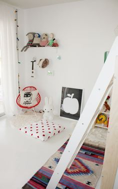 white floors and walls with colorful accents. #kids #decor