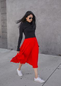 Black Turtleneck Sweater + Red Pleated Midi Skirt + White Sneakers