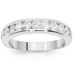 This exquisite womens diamond wedding band is crafted in 14K White Gold. Fourteen brilliant round cut diamonds are channel set in the center and total to 1.0 carats. The frame measures to 3/16 Inches in width and weighs approximately 5 grams. This glamorous womens diamond wedding band is an ideal gift for that special someone. $1,406.00