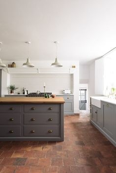 English country kitchen with brick flooring and island floor 6 Brick Kitchen Floor Ideas We're Currently Obsessing Over Devol Kitchens, Home Kitchens, Devol Shaker Kitchen, Rustic Kitchens, Kitchen Rustic, Dream Kitchens, Kitchen Colors, Kitchen Decor, Country Kitchen Tiles