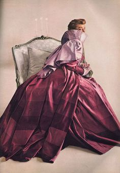 Love the ombre-like stripes of colour in the skirt of this enchanting 1940s evening gown.