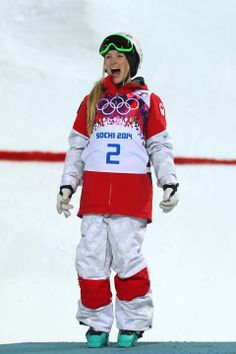 SOCHI, RUSSIA - FEBRUARY 08: Gold medalist Justine Dufour-Lapointe of Canada celebrates on the podium during the flower ceremony following the Ladies' Moguls Final 3 on day one of the Sochi 2014 Winter Olympics at Rosa Khutor Extreme Park on February 8, 2014 in Sochi, Russia. (Photo by Mike Ehrmann/Getty Images)