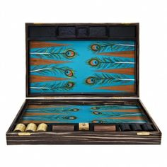 """Madeline Weinrib Favorite Gifts via Giftlab. Alexandra Llewellyn Peacock Backgammon Set, """"The peacock design adds a whimsical element to the typical backgammon set."""""""