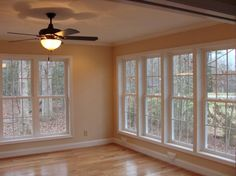 A shot showing a corner view of the sunroom and the central fan/light, built by Raleigh Sunroom Contractor Anthony and Company Construction