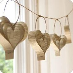 Recycled paper heart garland perfect for Valentine's Day. Decorate for a Valentines party with these. Book Crafts, Diy Crafts, Craft Books, Paper Heart Garland, Paper Garlands, Diy Garland, Paper Ornaments, Mesh Garland, Paper Wreaths