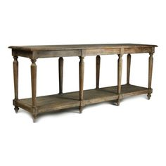 Alsace Buffet Table - As a console for a roomy entryway or in its intended purpose as a sideboard in a long dining room, the Alsace Buffet Table adds architectural detail with the turned colonnade of legs surrounding its under shelf, a display surface which is perfectly suited for holding spare dishes in a casual interior or displaying an over scale treasure in a more formal room.  Distressed wood is at home in any traditional style.