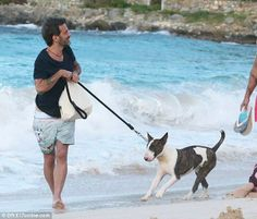 Marc Jacobs seen here wearing his OB Surfing Safari photographic print shorts in St Barths with his dog Neville.