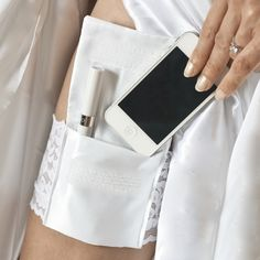 Here comes the bride!  Sexy French lace garter with 2 pockets to carry your cell phone, money, I.D., lipstick, keys, flask, & more! Savvy Cell Phone Solutions.  Go purse-free!  Hands-free!  $25.00+free shipping. Perfect bridesmaids gift, available in 12 colors.  www.stashbandz.com