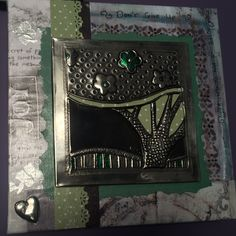 Mixed media creative block - decoupage on canvas with pewter embossed design from Mimmic Studio