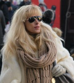 Stylish lady wearing white mink coat.  Prague street style
