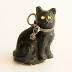 Victorian Czech glass lucky black cat cracker charm with original brass collar and glass eyes Measurements: tall x wide Good vintage condition with a chip around the edge of the base (probably manufacturing flaw), which is hard to notice Cat Jewelry, Animal Jewelry, Jewlery, Silly Cats, Cats And Kittens, Crazy Cat Lady, Crazy Cats, Art Nouveau, Statues