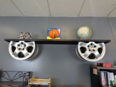 Vintage Furniture reuse car rims into repurposed furniture alloy wheels holders for wooden shelf decor idea - It is a great and unique idea to reuse car rims even if you like cars and all auto accessories. Car Part Furniture, Automotive Furniture, Automotive Decor, System Furniture, Furniture Plans, Woodworking Furniture, Woodworking Jointer, Bench Furniture, Modern Furniture