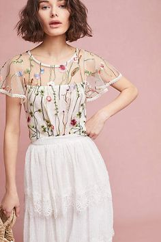 ccab75c9968 Shop new women s clothing at Anthropologie to discover your next favorite  closet staple.