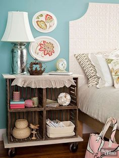 Turn crates into a charming bedside table packed with storage. First, screw four wood crates together for a country-inspired look. Measure a plywood top and bottom that are about 2 inches wider on each side than the width of the crates. Cut plywood with a table saw, and stain or paint plywood as desired. Secure the top and bottom to the crates with screws. Attach four 4-inch casters to the bottom of the table.