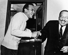 Dr. Martin Luther King Jr. and Harry Belafonte share a good laugh together.