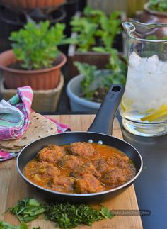 Soft dumplings made with grated lauki (bottle gourd) in Air fryer for healthy version and cooked to perfection in a flavorful gravy of tomatoes, onions and spices
