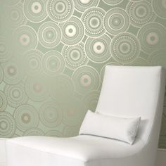 Danish Modern wallpaper-circular graphic can read as mid century, but the metallic pattern on the cool background is current.