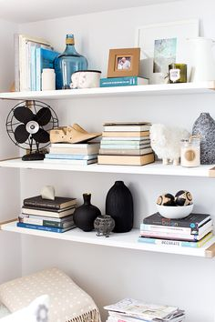 Pops of blue and black // shelf styling. #glitterguide