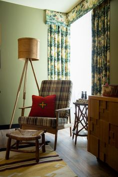 """In collaboration with children's brand Land of Nod and """"adult summer camp"""" Camp Wandawega, Graduate Hotels introduces a new suite that will have visitors singing Kumbaya. Themed Hotel Rooms, Theme Hotel, Plaid Chair, Printed Curtains, Patterned Curtains, Hotel Suites, Porch Swing, Architecture, Decoration"""