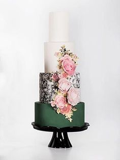 Add a bold statement to your wedding cake with a dark green design wedding cake paired with floral detailing.