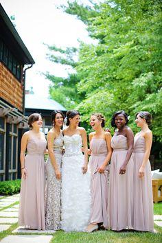 I absolutely love how the maid of honor is wearing a different dress than the bridesmaids -- but the dress still fits in perfectly for a cohesive look. This bride nailed it. Perfection!