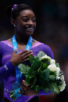 Simone Biles  | Simone Biles Simone Biles of USA poses after winning the silver medal ...