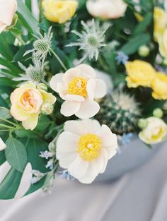 white and yellow centerpiece - photo by D'Arcy Benincosa Photography http://ruffledblog.com/minimalist-sand-dunes-wedding-inspiration #flowers #centerpieces
