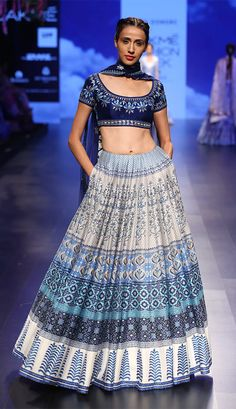 A model displays a designer lehenga, blouse and dupatta at one of the LFW events. (Source: THe Fan Boi)