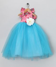 Take a look at this Pink & Blue Halter Dress