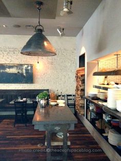 """Restaurant no. 246, white glazed """"brick tiles"""" from Portland, Oregon. Chef's pass and expedite table, reclaimed 2"""" thick Belgian Bluestone. Handspun sculpted lightshades."""