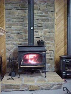 Ashlar style hearth, tan/grey with black stove.  Might feel mashed in my smaller hearth...
