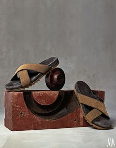 Brunello Cucinelli takes sporty, everyday sandals to the next level of sophistication with their Monilli Leather Flat Slides in gold and brown. Find these and similar styles at Neiman Marcus. #NMshoelove