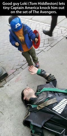 Good guy Loki (Tom Hiddleston) lets tiny Captain America knock him out on the set of The Avengers