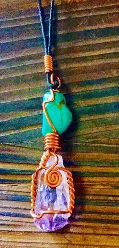 Handmade raw Amethyst and Turquoise stone copper wrapped pendant necklace. This stunning pendant comeson a black cord. Fashion jewelry,
