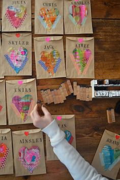 This heart-happy (& tree-friendly) project requires washi tape, alphabet stamps, and lots and lots of up-cycled hearts.