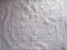 Beautiful modern whole cloth quilt, quilted on a long arm machine by