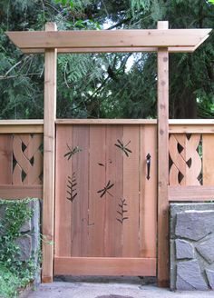 put this simple pergola over my deck gate.  Just need two 2x4, two 1x6 planks mitered on ends.  Nail to each other and the railing.