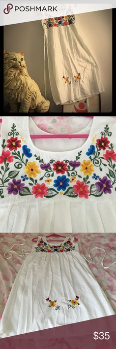 Bohemian Vintage Embroidered Dress Bohemian Vintage Embroidered Dress, perfect for a summer date, a day of antiquing or walk on the beach! Empire waist w tie..perfect for curves! Light weight muslin material. Sz 32; W 36, L 40; B 36. Vintage Dresses Midi
