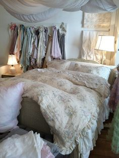 Shabby Chic bed from Rachel Ashwell Store. She is absolutely fabulous at designing. Love the colorful scarves hanging and the baby lamp on the side. The sheets from above are an interesting concept as well.