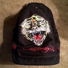 Ed Hardy ❤️Toby Trolley Backpack ❤️Discontinued Authentic Discontinued Ed Hardy/Christian Unisex Tiger,Tattoo Design Nylon Backpack❤️adjustable straps.for school, work, gym,travel❤️signature logo on front, top,strap & both sides of backpk 3 Lg zipper compartments.2side mesh pocket holders signature interior lining w/inside compartments❤️expandable handle telescopes,3stages,hides in.2Wheels for easy pull Adjst. straps w/mesh detail w/padding,back zipper flap,hide straps❤️tag still on❤sm.️hole…