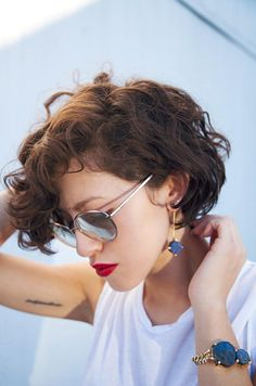 karla deras (karla_deras) on Twitter. Found her. She is a fashion blogger. I should follow her just for her hair.
